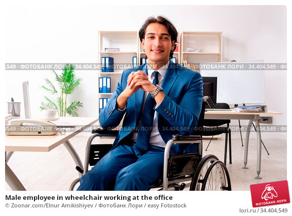 Male employee in wheelchair working at the office. Стоковое фото, фотограф Zoonar.com/Elnur Amikishiyev / easy Fotostock / Фотобанк Лори