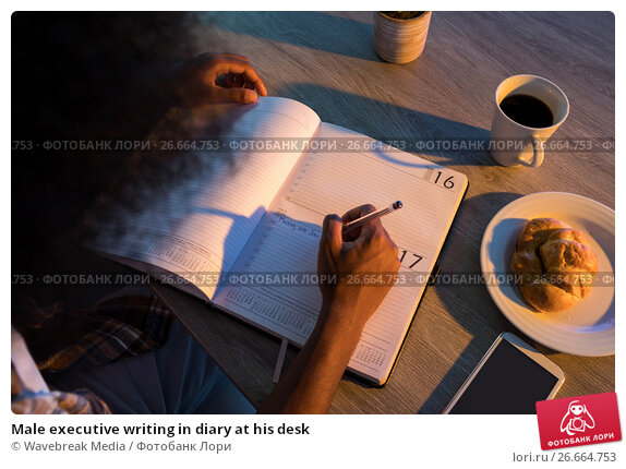 Купить «Male executive writing in diary at his desk», фото № 26664753, снято 19 марта 2017 г. (c) Wavebreak Media / Фотобанк Лори