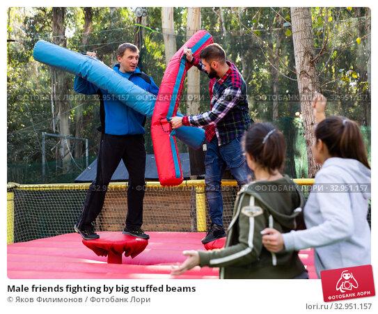Male friends fighting by big stuffed beams. Стоковое фото, фотограф Яков Филимонов / Фотобанк Лори