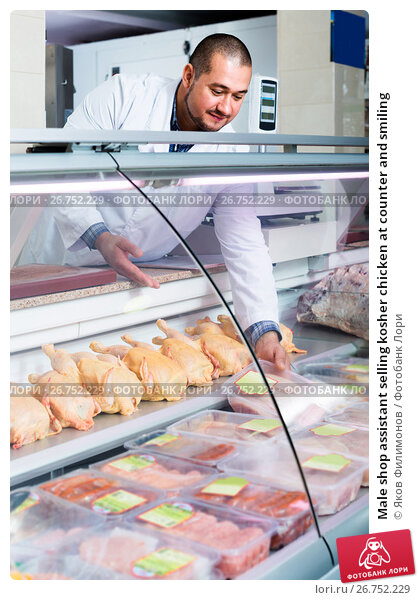 Male shop assistant selling kosher chicken at counter and for Kosher countertops