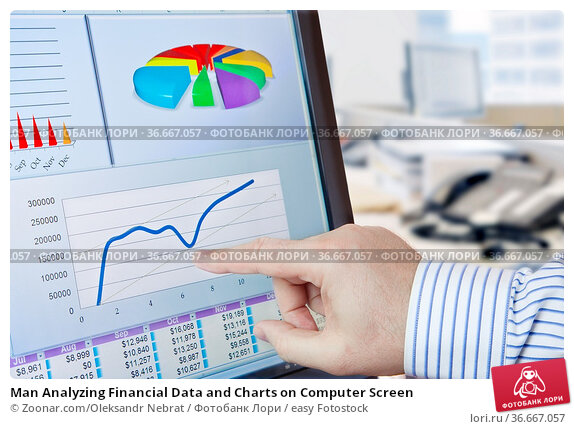 Man Analyzing Financial Data and Charts on Computer Screen. Стоковое фото, фотограф Zoonar.com/Oleksandr Nebrat / easy Fotostock / Фотобанк Лори