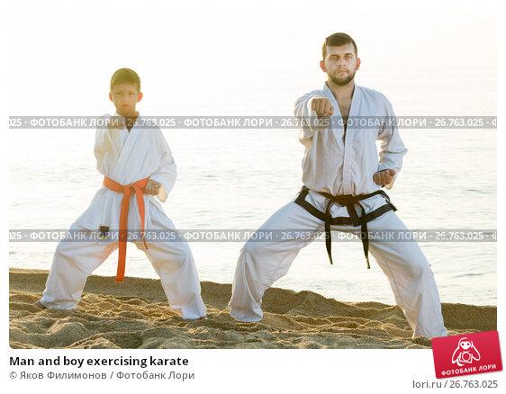 Купить «Man and boy exercising karate», фото № 26763025, снято 12 июля 2017 г. (c) Яков Филимонов / Фотобанк Лори
