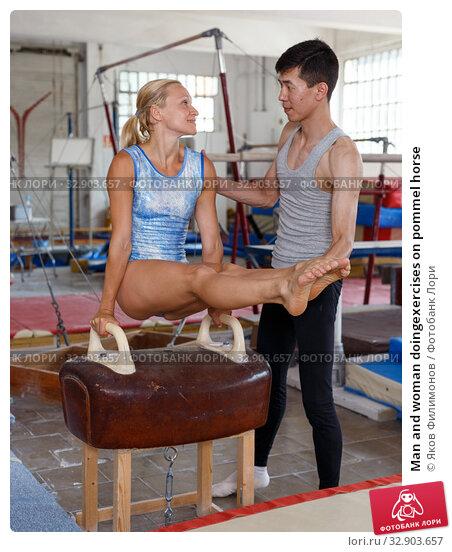 Man and woman doingexercises on pommel horse. Стоковое фото, фотограф Яков Филимонов / Фотобанк Лори