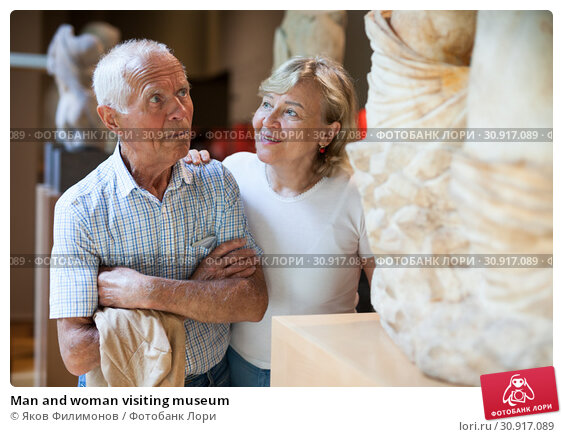 Купить «Man and woman visiting museum», фото № 30917089, снято 12 мая 2019 г. (c) Яков Филимонов / Фотобанк Лори