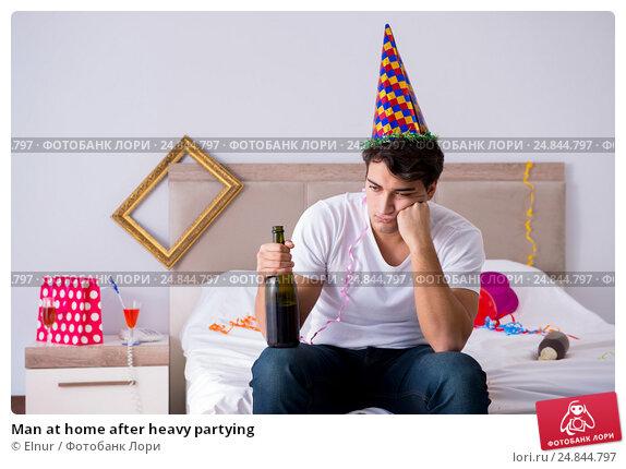 Купить «Man at home after heavy partying», фото № 24844797, снято 8 ноября 2016 г. (c) Elnur / Фотобанк Лори