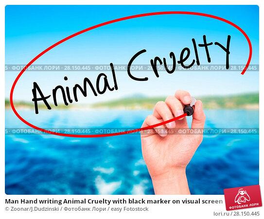 Купить «Man Hand writing Animal Cruelty with black marker on visual screen», фото № 28150445, снято 18 июня 2018 г. (c) easy Fotostock / Фотобанк Лори