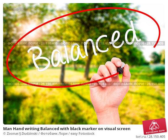 Купить «Man Hand writing Balanced with black marker on visual screen», фото № 28150405, снято 21 июня 2018 г. (c) easy Fotostock / Фотобанк Лори