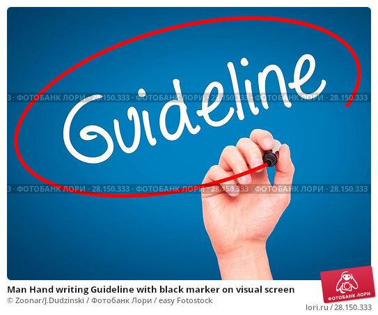 Купить «Man Hand writing Guideline with black marker on visual screen», фото № 28150333, снято 19 июня 2018 г. (c) easy Fotostock / Фотобанк Лори