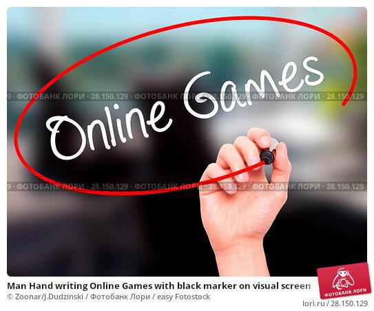 Купить «Man Hand writing Online Games with black marker on visual screen», фото № 28150129, снято 18 июня 2018 г. (c) easy Fotostock / Фотобанк Лори