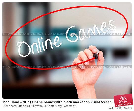 Купить «Man Hand writing Online Games with black marker on visual screen», фото № 28150249, снято 22 июня 2018 г. (c) easy Fotostock / Фотобанк Лори