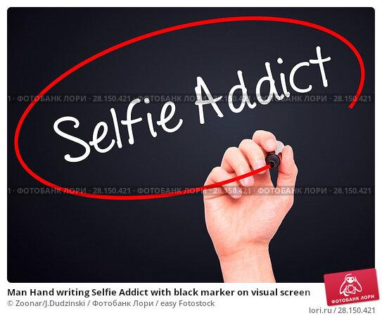 Купить «Man Hand writing Selfie Addict with black marker on visual screen», фото № 28150421, снято 18 июня 2018 г. (c) easy Fotostock / Фотобанк Лори