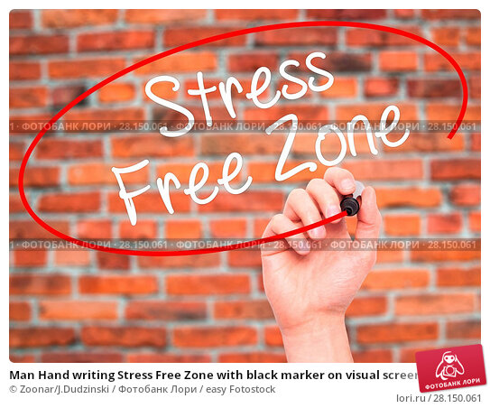 Купить «Man Hand writing Stress Free Zone with black marker on visual screen», фото № 28150061, снято 19 июня 2018 г. (c) easy Fotostock / Фотобанк Лори