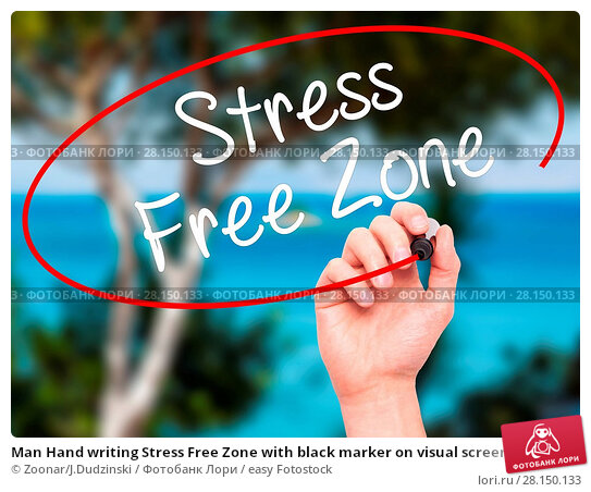 Купить «Man Hand writing Stress Free Zone with black marker on visual screen», фото № 28150133, снято 22 июня 2018 г. (c) easy Fotostock / Фотобанк Лори