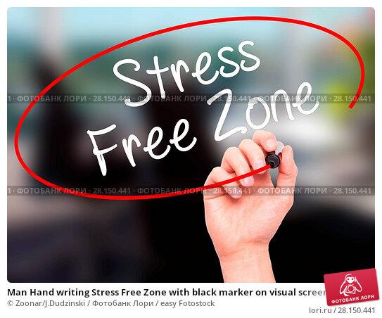 Купить «Man Hand writing Stress Free Zone with black marker on visual screen», фото № 28150441, снято 19 июня 2018 г. (c) easy Fotostock / Фотобанк Лори