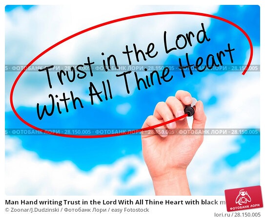 Купить «Man Hand writing Trust in the Lord With All Thine Heart with black marker on visual screen», фото № 28150005, снято 19 июня 2018 г. (c) easy Fotostock / Фотобанк Лори