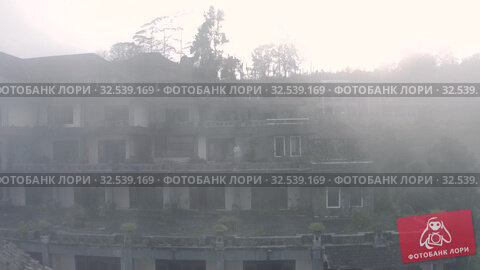 Купить «Man in lost fog place Drone flight above Abandoned hotel in strong Fog in Bali», видеоролик № 32539169, снято 28 октября 2019 г. (c) Aleksejs Bergmanis / Фотобанк Лори