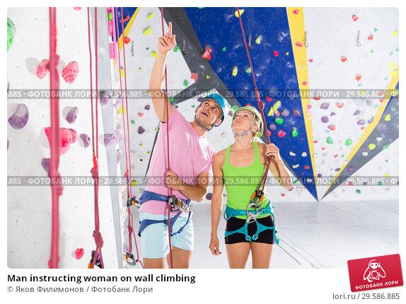 Купить «Man instructing woman on wall climbing», фото № 29586885, снято 9 июля 2018 г. (c) Яков Филимонов / Фотобанк Лори