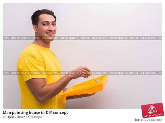 Купить «Man painting house in DIY concept», фото № 24668085, снято 30 сентября 2016 г. (c) Elnur / Фотобанк Лори