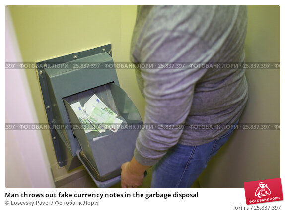 Купить «Man throws out fake currency notes in the garbage disposal», фото № 25837397, снято 1 мая 2015 г. (c) Losevsky Pavel / Фотобанк Лори