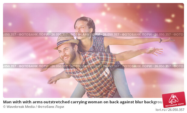 Купить «Man with with arms outstretched carrying woman on back against blur background», фото № 26050357, снято 21 февраля 2019 г. (c) Wavebreak Media / Фотобанк Лори