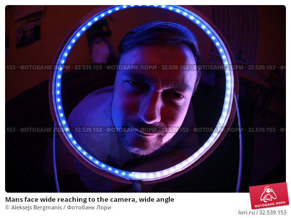 Купить «Mans face wide reaching to the camera, wide angle», фото № 32539153, снято 20 июля 2019 г. (c) Aleksejs Bergmanis / Фотобанк Лори