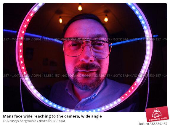 Купить «Mans face wide reaching to the camera, wide angle», фото № 32539157, снято 20 июля 2019 г. (c) Aleksejs Bergmanis / Фотобанк Лори