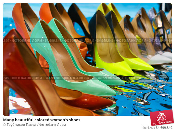 Many beautiful colored women's shoes. Редакционное фото, фотограф Трубников Павел / Фотобанк Лори