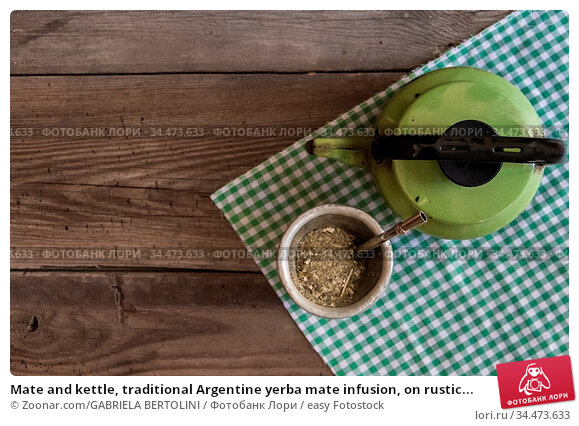Mate and kettle, traditional Argentine yerba mate infusion, on rustic... Стоковое фото, фотограф Zoonar.com/GABRIELA BERTOLINI / easy Fotostock / Фотобанк Лори
