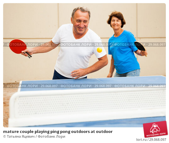 mature couple playing ping pong outdoors at outdoor. Стоковое фото, фотограф Татьяна Яцевич / Фотобанк Лори