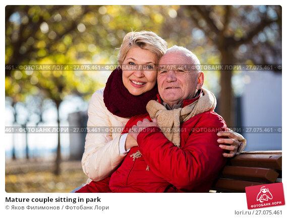 Купить «Mature couple sitting in park», фото № 27075461, снято 14 декабря 2017 г. (c) Яков Филимонов / Фотобанк Лори