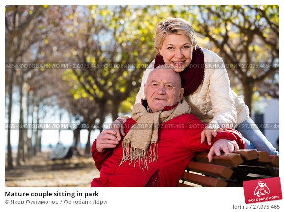 Купить «Mature couple sitting in park», фото № 27075465, снято 11 декабря 2017 г. (c) Яков Филимонов / Фотобанк Лори
