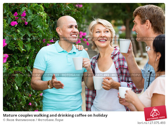 Mature couples walking and drinking coffee on holiday, фото № 27075493, снято 25 июля 2017 г. (c) Яков Филимонов / Фотобанк Лори