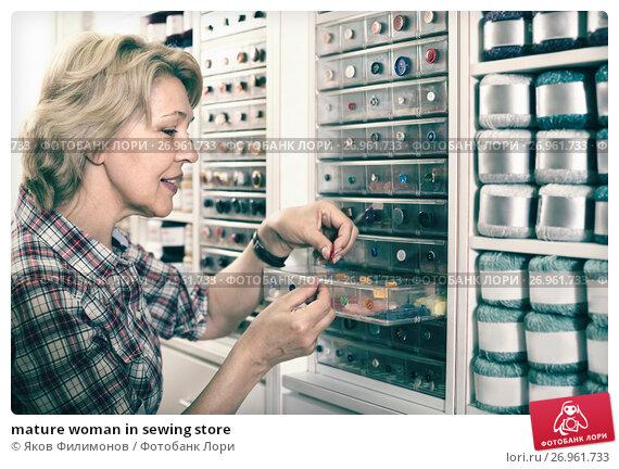Купить «mature woman in sewing store», фото № 26961733, снято 23 мая 2019 г. (c) Яков Филимонов / Фотобанк Лори