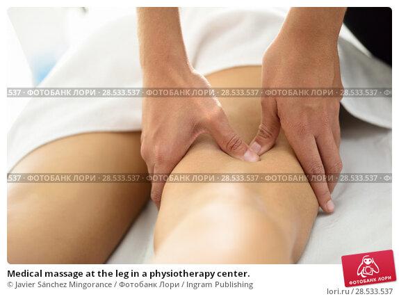 Купить «Medical massage at the leg in a physiotherapy center.», фото № 28533537, снято 23 ноября 2017 г. (c) Ingram Publishing / Фотобанк Лори