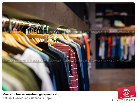 Men clothes in modern garments shop. Стоковое фото, фотограф Яков Филимонов / Фотобанк Лори