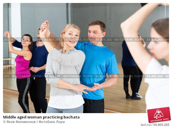 Middle aged woman practicing bachata. Стоковое фото, фотограф Яков Филимонов / Фотобанк Лори