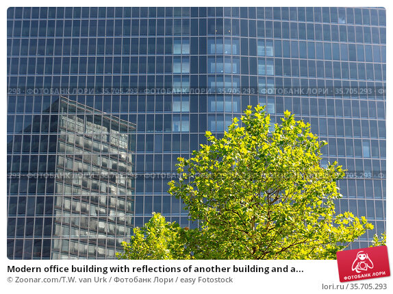 Modern office building with reflections of another building and a... Стоковое фото, фотограф Zoonar.com/T.W. van Urk / easy Fotostock / Фотобанк Лори
