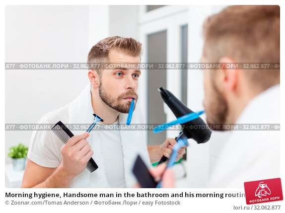 Morning hygiene, Handsome man in the bathroom and his morning routine. Стоковое фото, фотограф Zoonar.com/Tomas Anderson / easy Fotostock / Фотобанк Лори