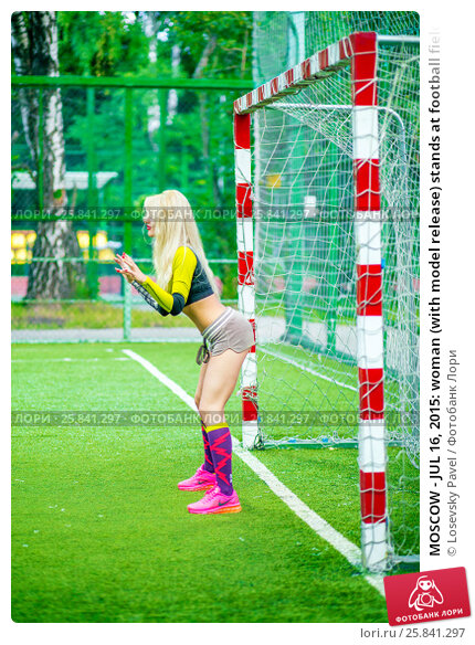 Купить «MOSCOW - JUL 16, 2015: woman (with model release) stands at football field at gate ready to catch ball, looks at him», фото № 25841297, снято 16 июля 2015 г. (c) Losevsky Pavel / Фотобанк Лори