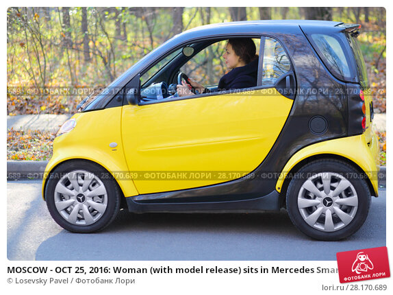 Купить «MOSCOW - OCT 25, 2016: Woman (with model release) sits in Mercedes Smart in Sokolniki where conducted Auto Show - Oldtimer, Gallery», фото № 28170689, снято 25 октября 2016 г. (c) Losevsky Pavel / Фотобанк Лори