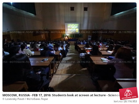 Купить «MOSCOW, RUSSIA - FEB 17, 2016: Students look at screen at lecture - Sciences in University of Moscow, Latest achievements. at Faculty of journalism in Lomonosov moscow state university», фото № 28116953, снято 17 февраля 2016 г. (c) Losevsky Pavel / Фотобанк Лори