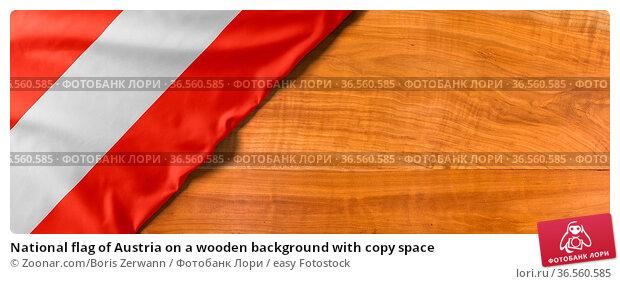 National flag of Austria on a wooden background with copy space. Стоковое фото, фотограф Zoonar.com/Boris Zerwann / easy Fotostock / Фотобанк Лори