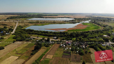 Купить «Natural landscape of central Russia with field, river and pond in fall. downward movement», видеоролик № 29600665, снято 21 декабря 2018 г. (c) Володина Ольга / Фотобанк Лори