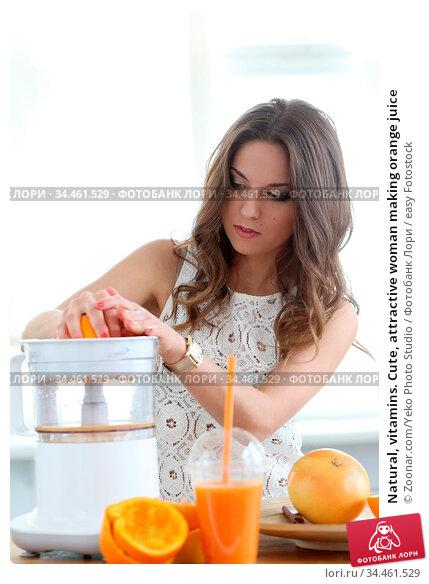 Natural, vitamins. Cute, attractive woman making orange juice. Стоковое фото, фотограф Zoonar.com/Yeko Photo Studio / easy Fotostock / Фотобанк Лори
