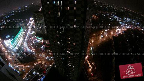 Купить «Небоскребы стоят в окружении автодорог ночью (таймлапс)», видеоролик № 3774549, снято 31 января 2012 г. (c) Losevsky Pavel / Фотобанк Лори