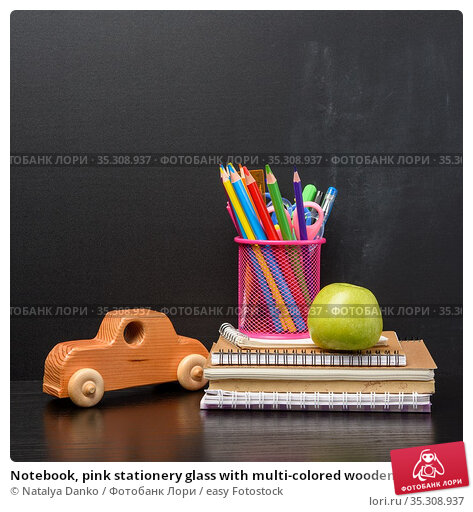 Notebook, pink stationery glass with multi-colored wooden pencils... Стоковое фото, фотограф Natalya Danko / easy Fotostock / Фотобанк Лори