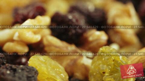 Купить «Nuts and dried fruits in bulk», видеоролик № 27540629, снято 20 октября 2017 г. (c) Потийко Сергей / Фотобанк Лори