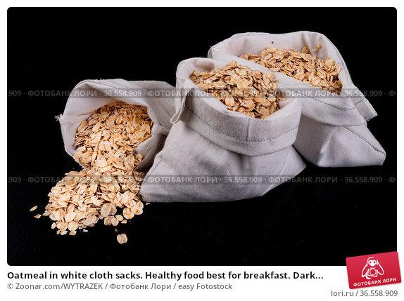 Oatmeal in white cloth sacks. Healthy food best for breakfast. Dark... Стоковое фото, фотограф Zoonar.com/WYTRAZEK / easy Fotostock / Фотобанк Лори