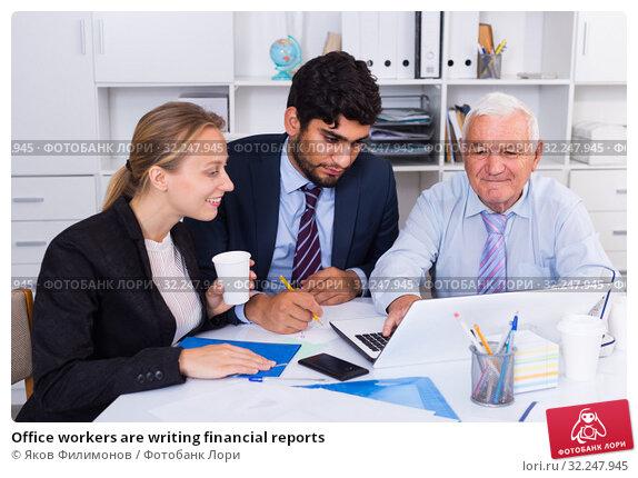 Купить «Office workers are writing financial reports», фото № 32247945, снято 27 июня 2017 г. (c) Яков Филимонов / Фотобанк Лори