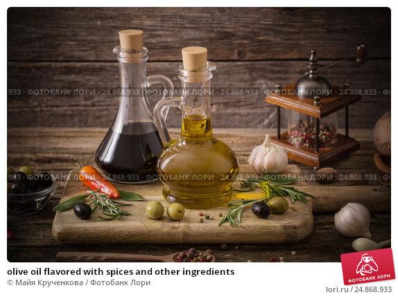 Купить «olive oil flavored with spices and other ingredients», фото № 24868933, снято 24 ноября 2016 г. (c) Майя Крученкова / Фотобанк Лори